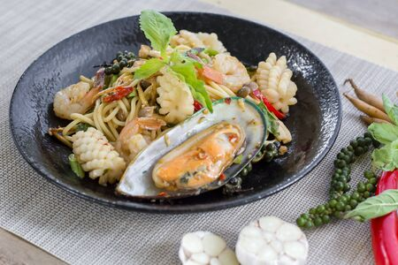 Stir-fried spicy spaghetti with seafoods, also known as drunken spaghetti or Phad Kee Mao Spaghetti Stock Photo