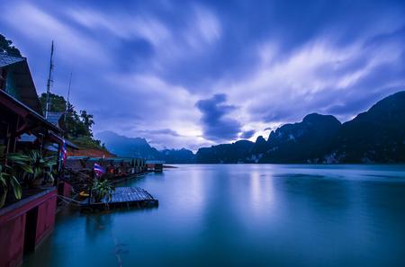 View of Ratchaprapa Dam with fog in raining season When sunrise Twilight at Surat Thani, Thailand