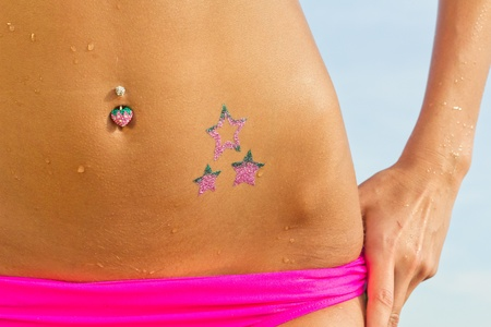 piercing: Woman posing with glitter-tattoo