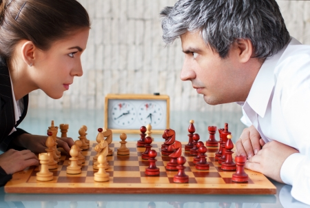 game time: Woman and man competition, chess in the office