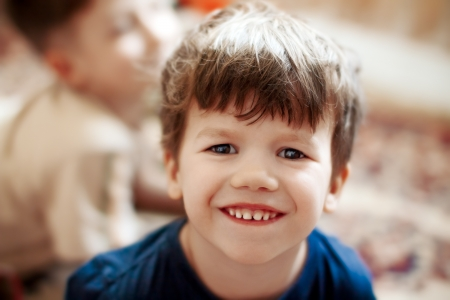 grandsons: Little caucasian boy smiling, brother background