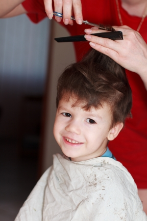 Haircut for boy at home photo