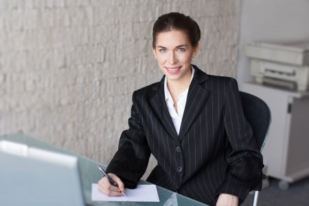 interpret: Successful businesswoman with teeth smile in office, signing document