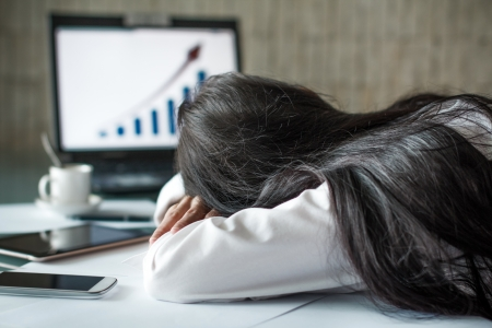 night shift: Tired businesswoman sleeping in office, overtime