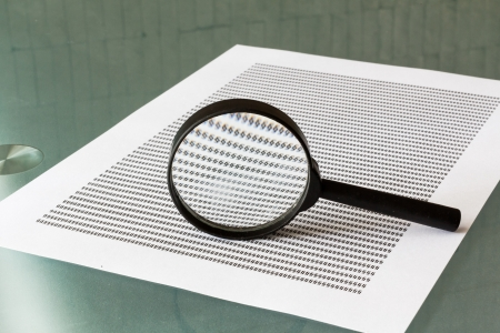 Law investigation, magnifying glass with document on table photo