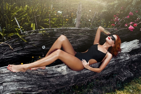 Sexy redhead woman with black sunglasses, outdoor photo