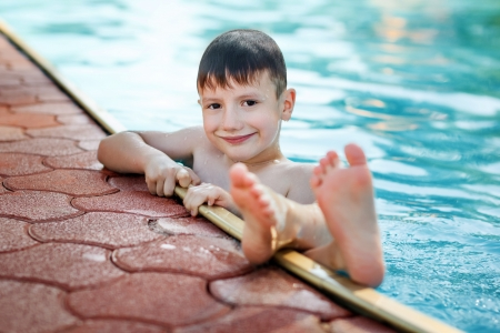 Little boy in the pool, sole up