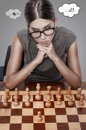 Beautiful chess player thinking, first move photo