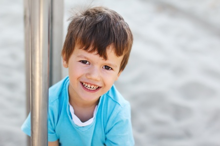 Cute little boy with teeth smile, outdoor photo