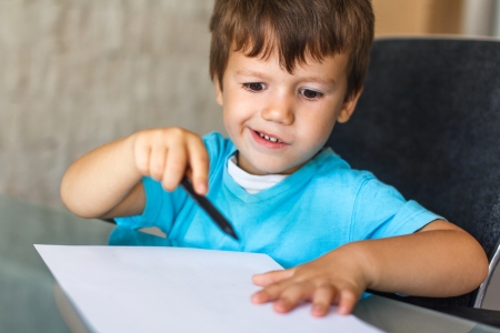 talented: Little talented child start drawing, education Stock Photo