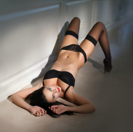Sexy woman in underwear laying of floor  photo