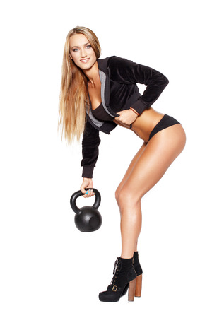 Sexy blonde woman with kettlebell, isolated on white photo