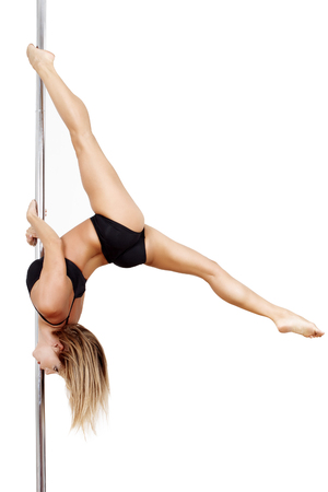Pole dancer practice upside down, isolated photo