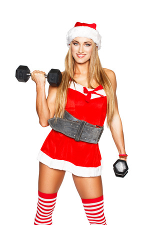 Sexy blonde fitness woman with two dumbbell, isolated, christmas