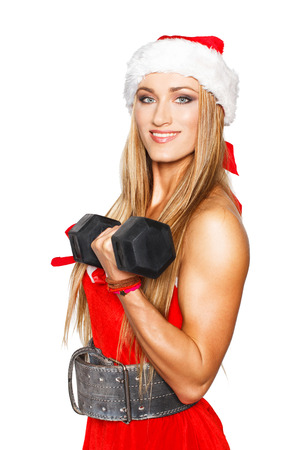 Sexy blonde fitness woman with dumbbell, isolated, christmas photo