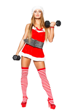Sexy fitness model with dumbbells, isolated photo