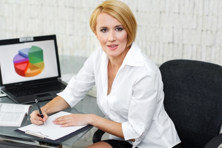 Businesswoman write on white paper, office photo