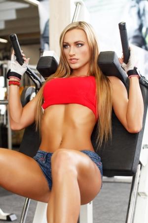 Beautiful fitness model workout, squat Stock Photo - 23339064