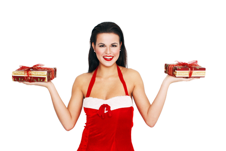 Sexy santa woman holding two gifts, isolated on white, empty space photo
