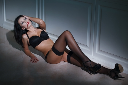 Sexy vampire woman laying on the floor at night photo