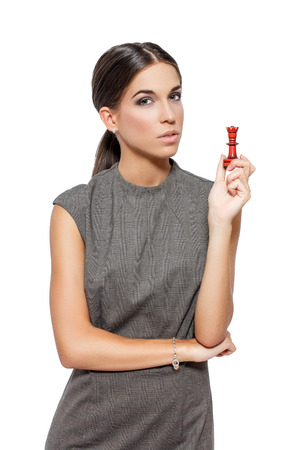 Woman with chess figure, strategy, isolated photo