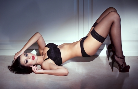 Sensual woman posing on floor at night photo