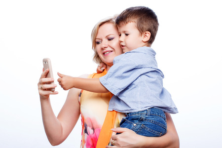Mother and son with smartphone, wireless technology, isolated on white background photo