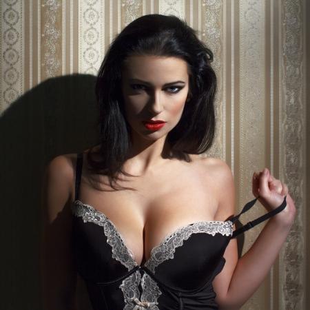 Sensual brunette woman at night portrait photo