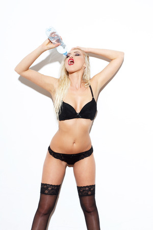 Sexy blonde woman in underwear drink water  photo