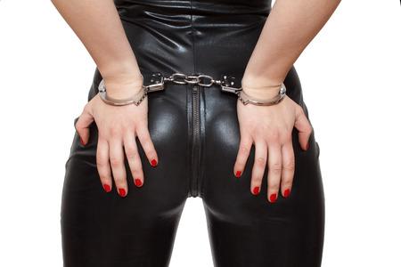セクシーなミストレス手をお尻手錠をかけられて、クローズ アップ、白で隔離されます。
