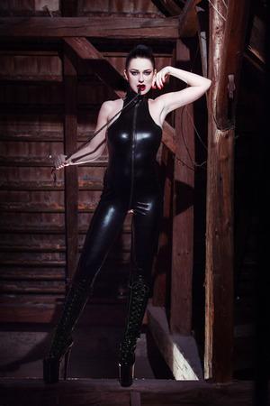 Beautiful fetish model with whip, seduction photo
