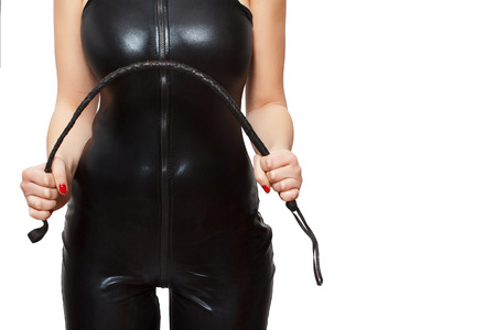 Woman in latex catsuit and whip, isolated on white background photo