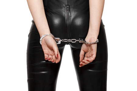 Cuffed woman closeup, isolated on white background photo