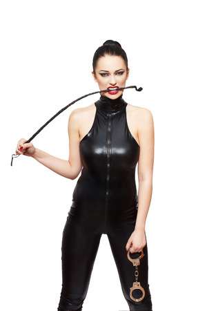 Sexy dominatrix with whip and handcuffs, isolated on white background Stock Photo