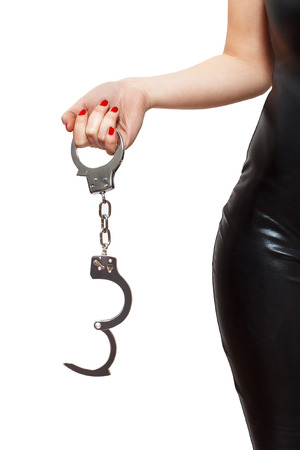 Dominatrix holding handcuffs, isolated on white background Stock Photo