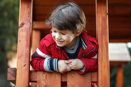 jungle gym: Happy young boy on jungle gym, outdoor portrait Stock Photo