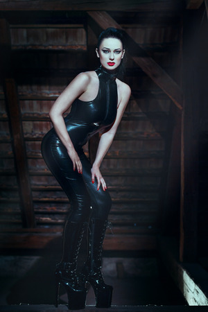 Sexy dominatrix at midnight photo