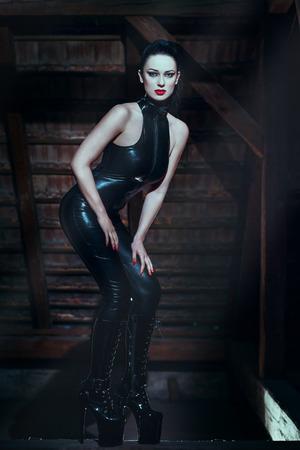 Sexy dominatrix at midnight photo