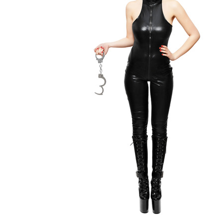 Dominatrix holding handcuffs, isolated on white background photo