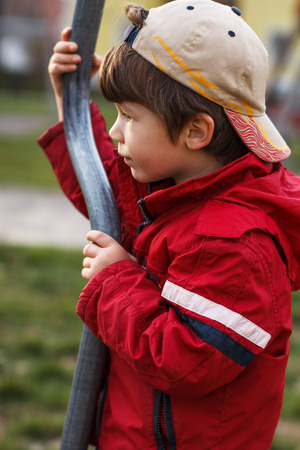 jungle gym: Little boy at outdoor with pole, jungle gym Stock Photo