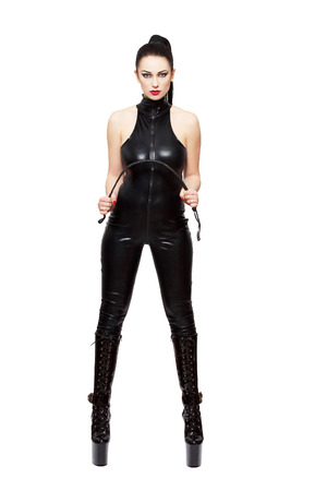 Sexy woman in latex catsuit and whip, isolated on white background photo