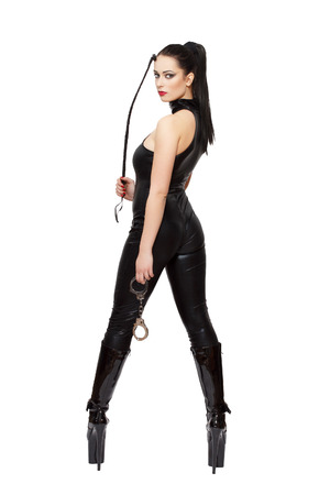 Sexy woman in latex catsuit, boots and whip, isolated on white background photo