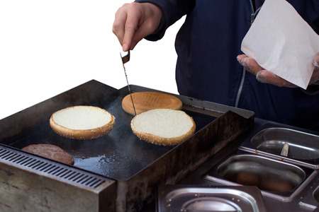 barbequing: Man making and hamburger isolated on white Stock Photo