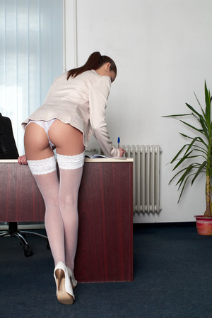 nude ass: Sexy secretary in office writing with pen, rear view