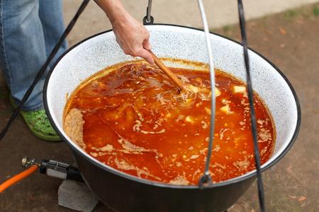 caldron: Preparing hungarian goulash, cooking