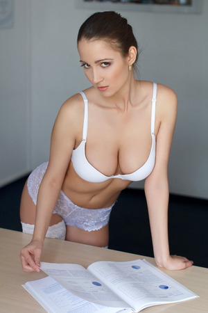tits: Sexy secretary with catalog in office, seduction Stock Photo