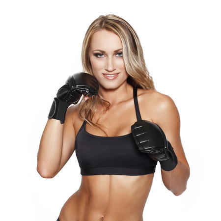 girl punch: Blonde woman in gloves punch, karate, crossfit