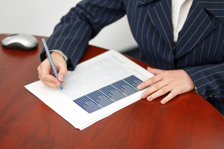 Office worker fill form in office with pen photo
