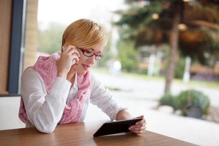 Happy young manager call by smartphone in restaurant, indoor portrait photo