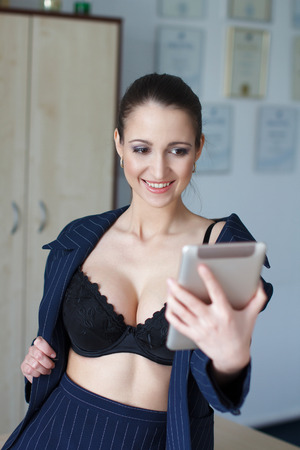 tits: Sexy ceo in bra flirting on tablet